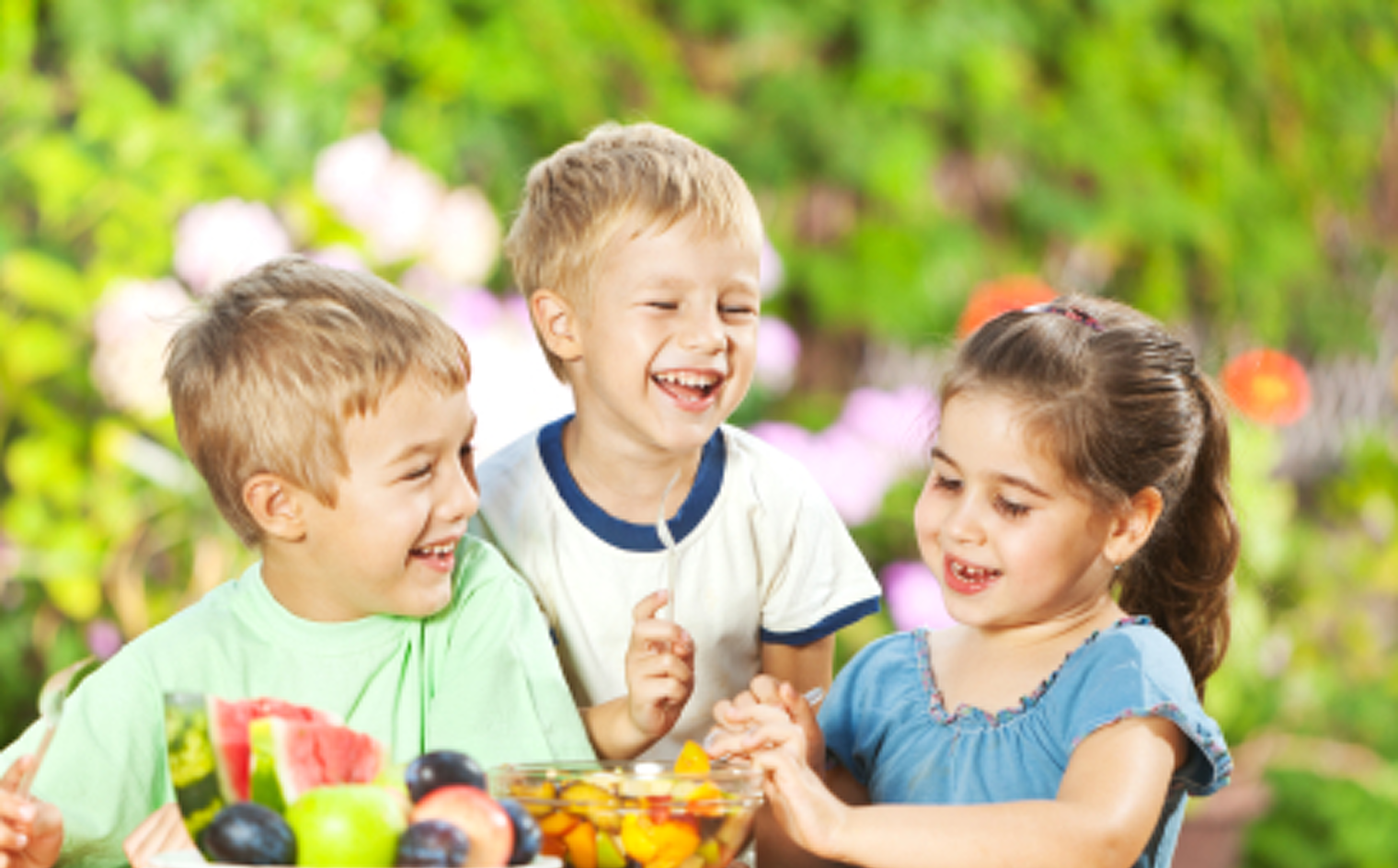 photo of 3 children eating fruits